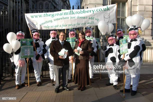 Young farmers from Devon stand on Whitehall in Westminster London dressed as cows are joined by campaign organiser Sally Dare and Neil Parish...