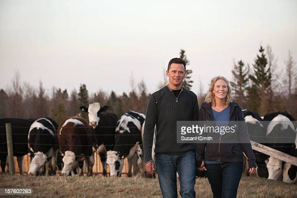 Young farmers with cattle