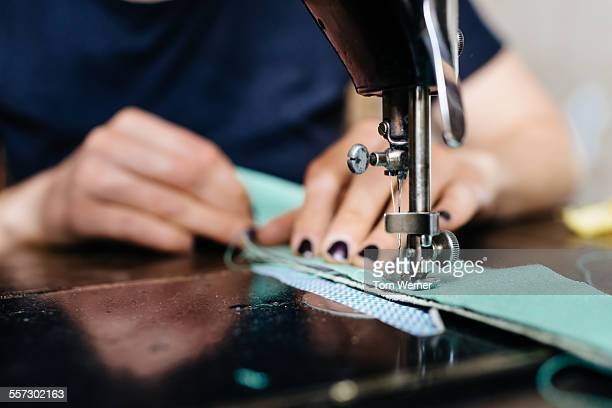 Young Fashion Designer Working On Sewing Machine