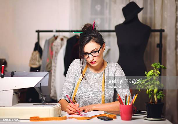 Young fashion designer working until late