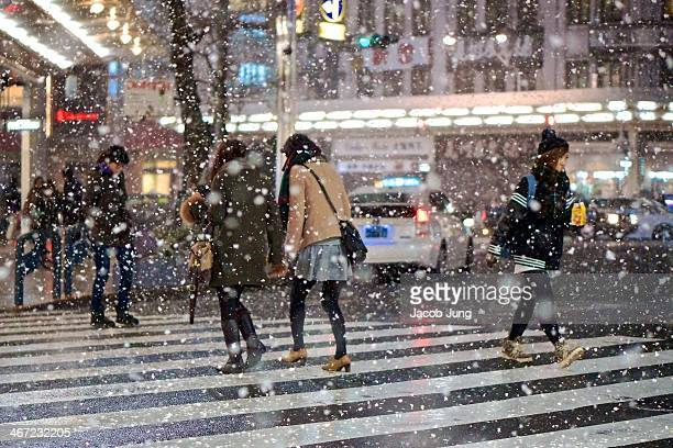 Young fashionable people crossing the street during a snow storm in Kyoto