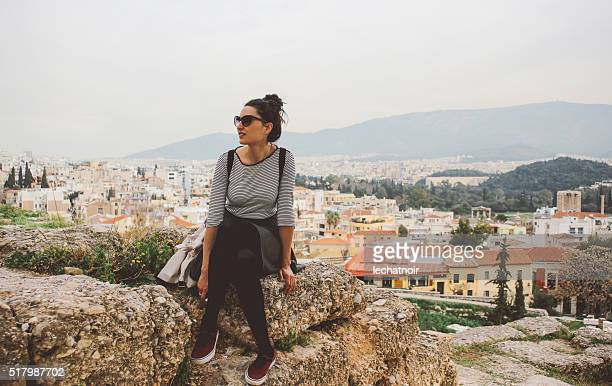 Young fashionable tourist woman relaxing and sightseeing in Athens, Greece