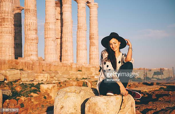 Young fashionable tourist woman relaxing and sightseeing in Greece