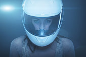 Young fashionable woman in helmet at night portrait, high extreme fashion