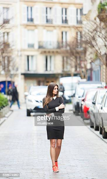 Young Fashionable Woman Wandering In The City