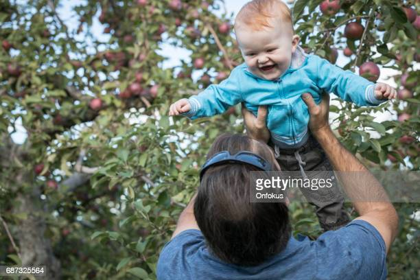 Young Father and her Son Picking Apples