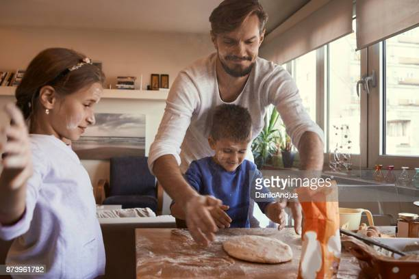 young father baking with his children