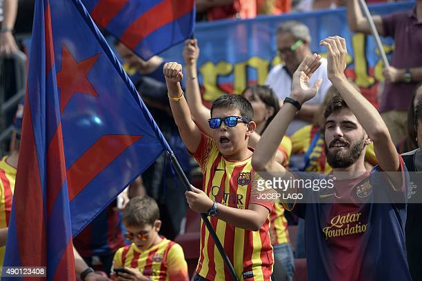 A young FC Barcelona's supporter waves a 'estelada' with the FC Barcelona's colours on it before the Spanish league football match FC Barcelona vs UD...