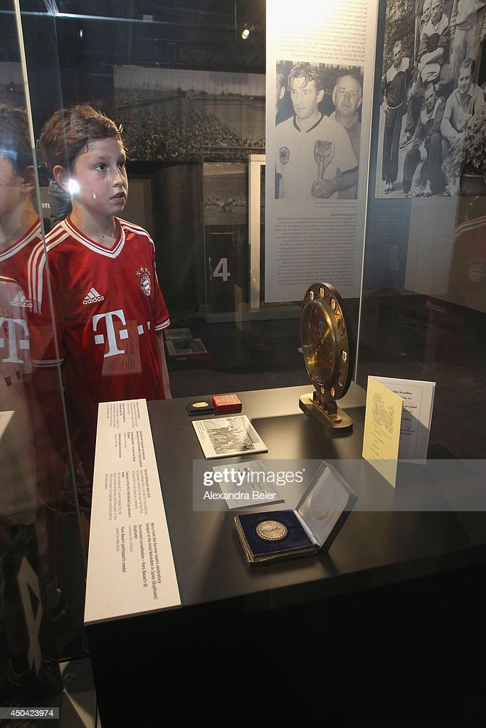 A young FC Bayern Muenchen fan looks at exhibits during the opening day of a World Cup 1954 exhibition at Allianz Arena Erlebniswelt museum on June 11, 2014 in Munich, Germany.