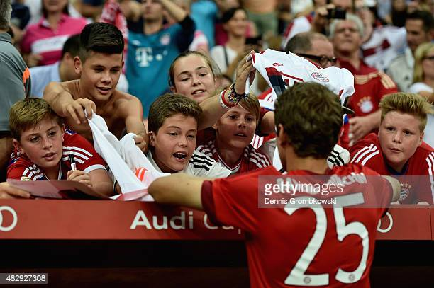 Young FC Bayern Muenchen supporters cheer for autographs by Thomas Mueller during the Audi Cup 2015 match between FC Bayern Muenchen and AC Milan at...