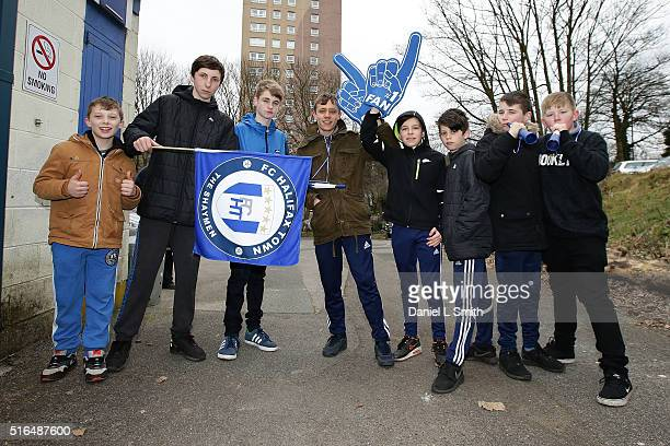 Young FC Halifax Town fans pose for a photograph prior to the FA Trophy Semi Final Second Leg match between FC Halifax Town and Nantwich Town at The...