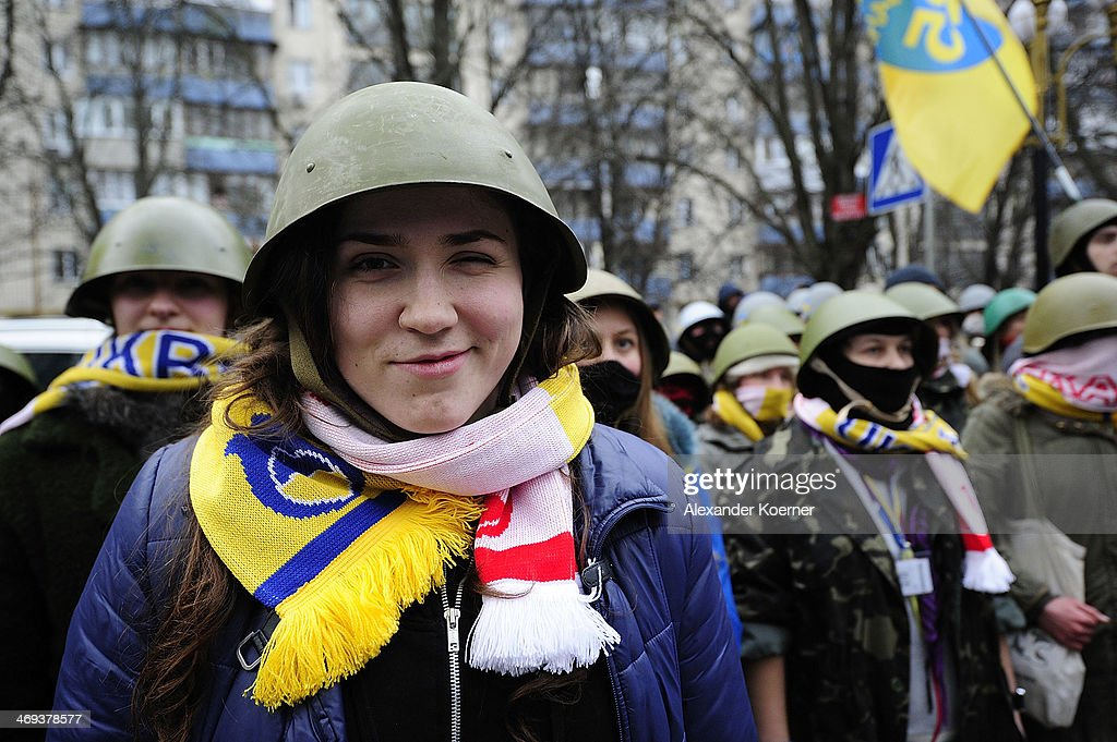 A young female anti-government protester smiles during a rally on Instytutska Street on February 14, 2014, in Kiev, Ukraine. According to Opposition Officals, Berkut police forces could attack the barricades any moment; protesters have gathered inside and prepared fireworks and molotov-cocktails. Media and other people were removed from the barricades. Russian Foreign Minister Sergei Lavrov again issued a warning to the West against interfering in Ukraine's political crisis during today's joint press conference with German federal foreign Minister Walter Steinmeier, who is on a two-day visit to Russia. According to reports Ukrainian opposition leaders Vitaly Klitschko and Arseny Yatsenyuk are set to meet with German Chancellor Angela Merkel on February 18, 2014 in Germany.