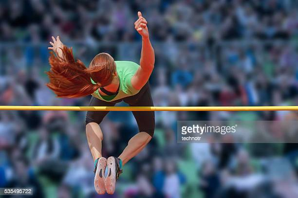 Young female athlete at high jump
