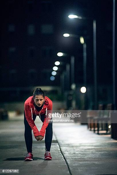 Young female athlete taking a breath