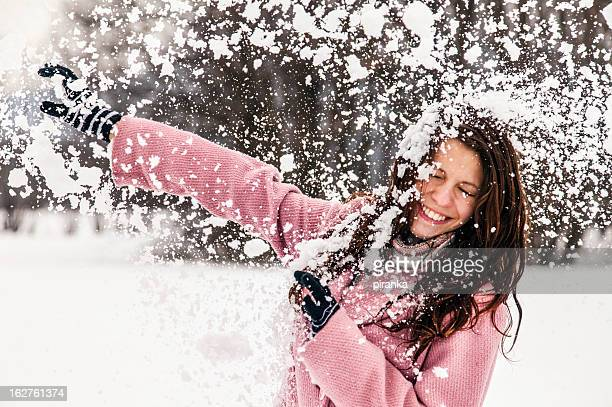 Young female being hit by a snowball
