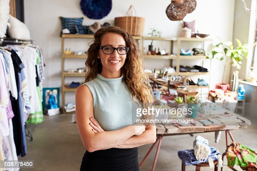 Young female business owner in a clothes shop, portrait : Foto stock
