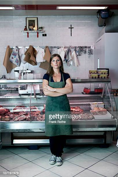 young female butcher in here shop