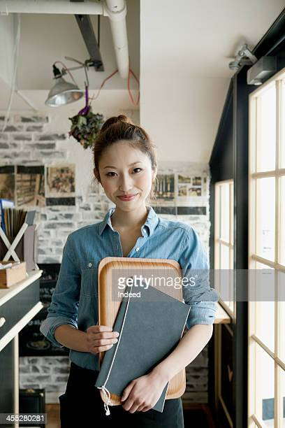 Young female cafe salesclerk