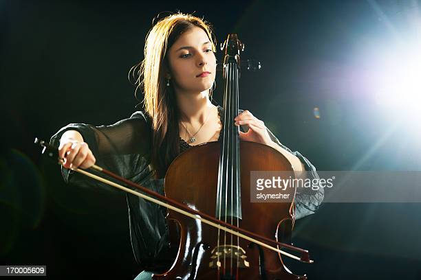 Young female cellist.