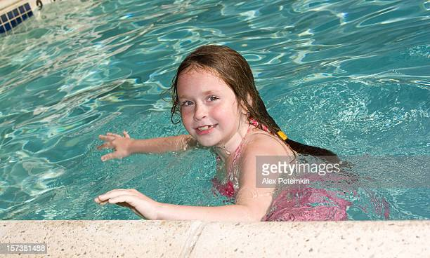 Young female child swimming.