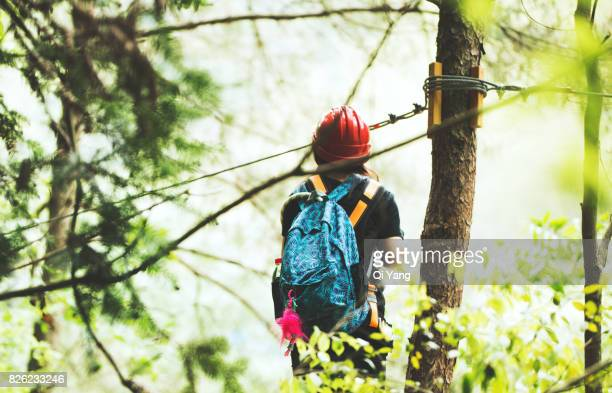 Young female climber in forest ,China