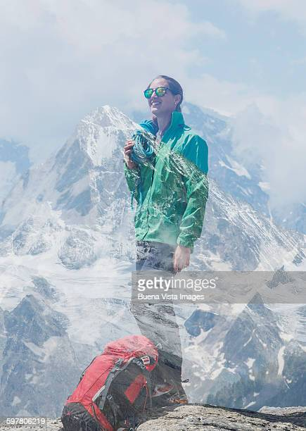 Young female climber on a mountaintop