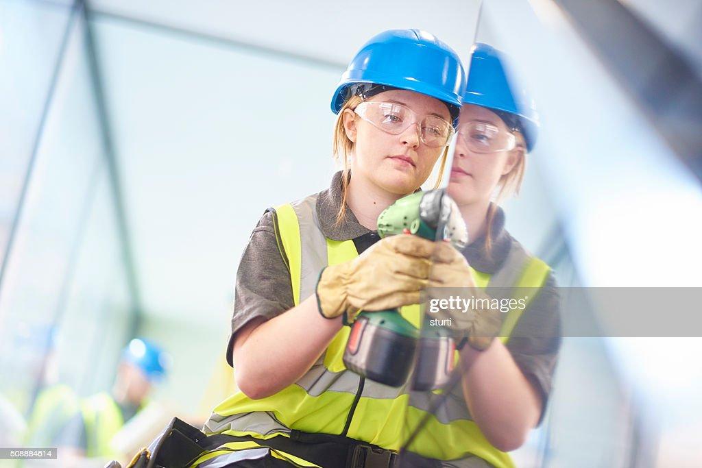 Junge weibliche Bau Arbeiter : Stock-Foto