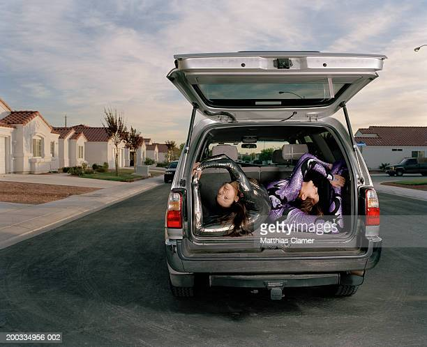 Young female contortionists practicing in vehicle