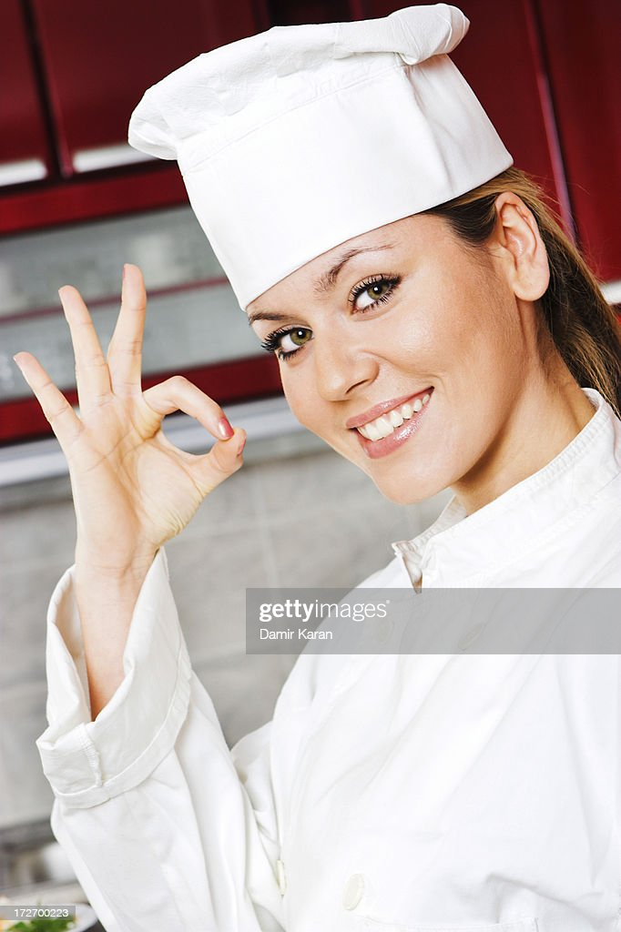 Young female cook : Stock Photo
