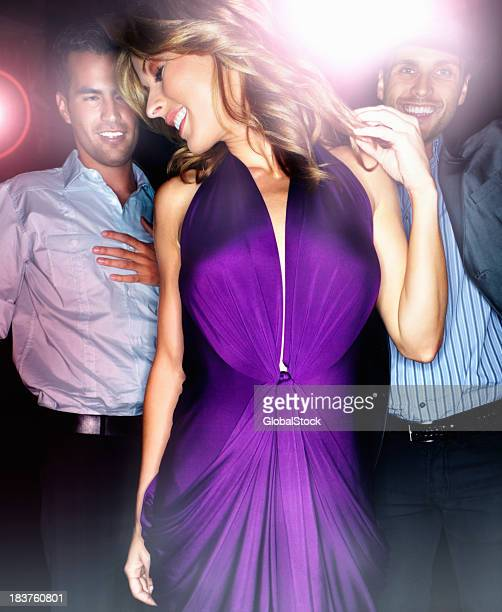 Young female dancing at a night club