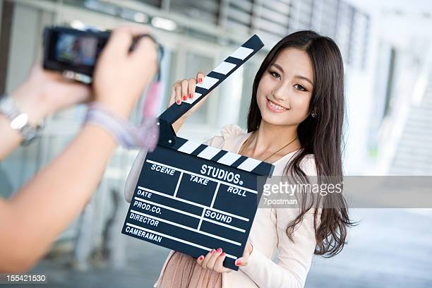 Young Female Director with slate