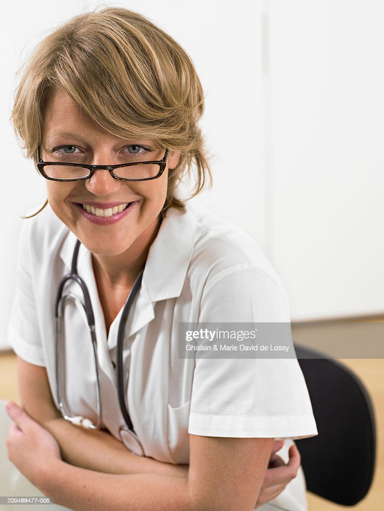 Young female doctor smiling, portrait : Stock Photo