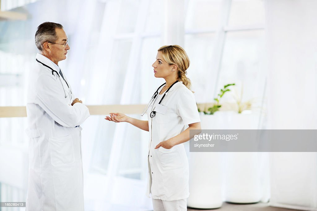 Young female doctor with  senior colleague. : Stock Photo