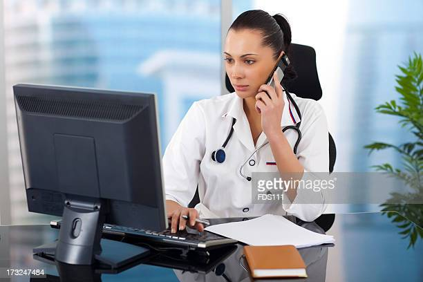 Young female doctor working on a computer