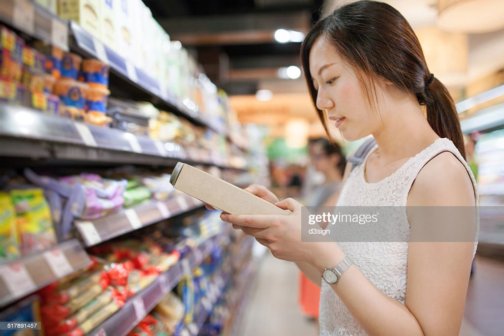 Young female doing grocery shopping in market