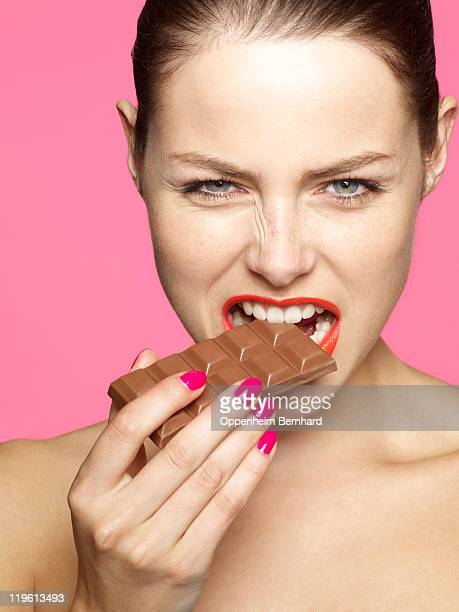 young female eating chocolate