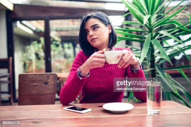 Young Female Enjoying Coffee Break at the Restaurant