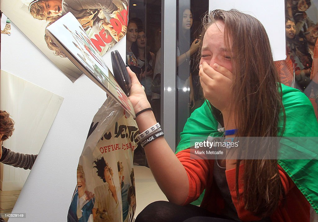 A young female fan is seen crying after purchasing merchandise at the One Direction promotional store opening on Pitt Street on April 7, 2012 in Sydney, Australia. The store is the only official One Direction merchandise retail venue in Australia and will only be open until April 20. One Direction kicks off their Australian tour in Sydney next week.