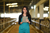 Young female farmer using a digital tablet