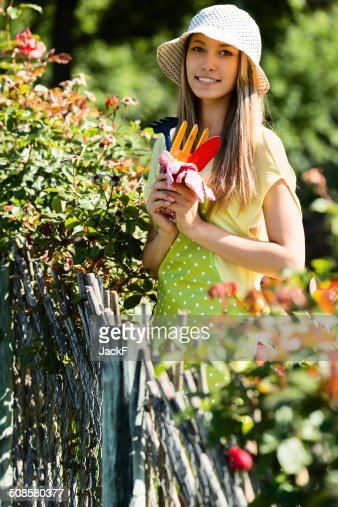 young female florists in apron working : Stockfoto
