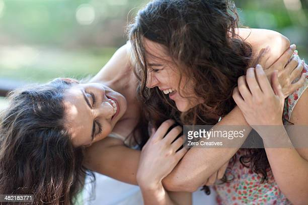 Young female friends enjoying playfight