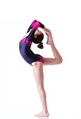 Young female gymnast performingYoung female gymnast performing