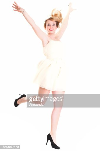 Young female Happy woman jumping with arms up isolated : Stock Photo