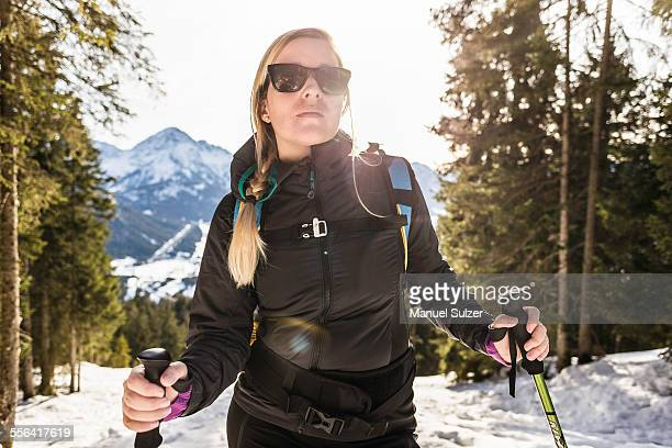 Young female hiker in snow covered forest, Reutte, Tyrol, Austria