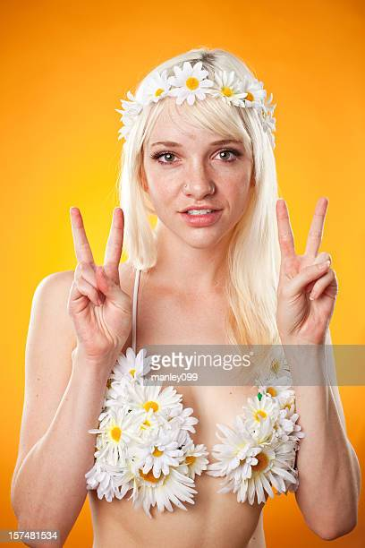 young female hippie with peace sign