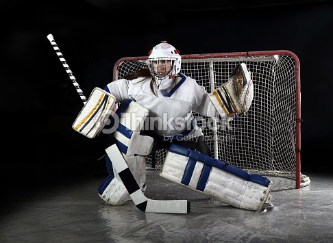 Young Female Hockey Goalie Makes A Save Stock Photo Thinkstock