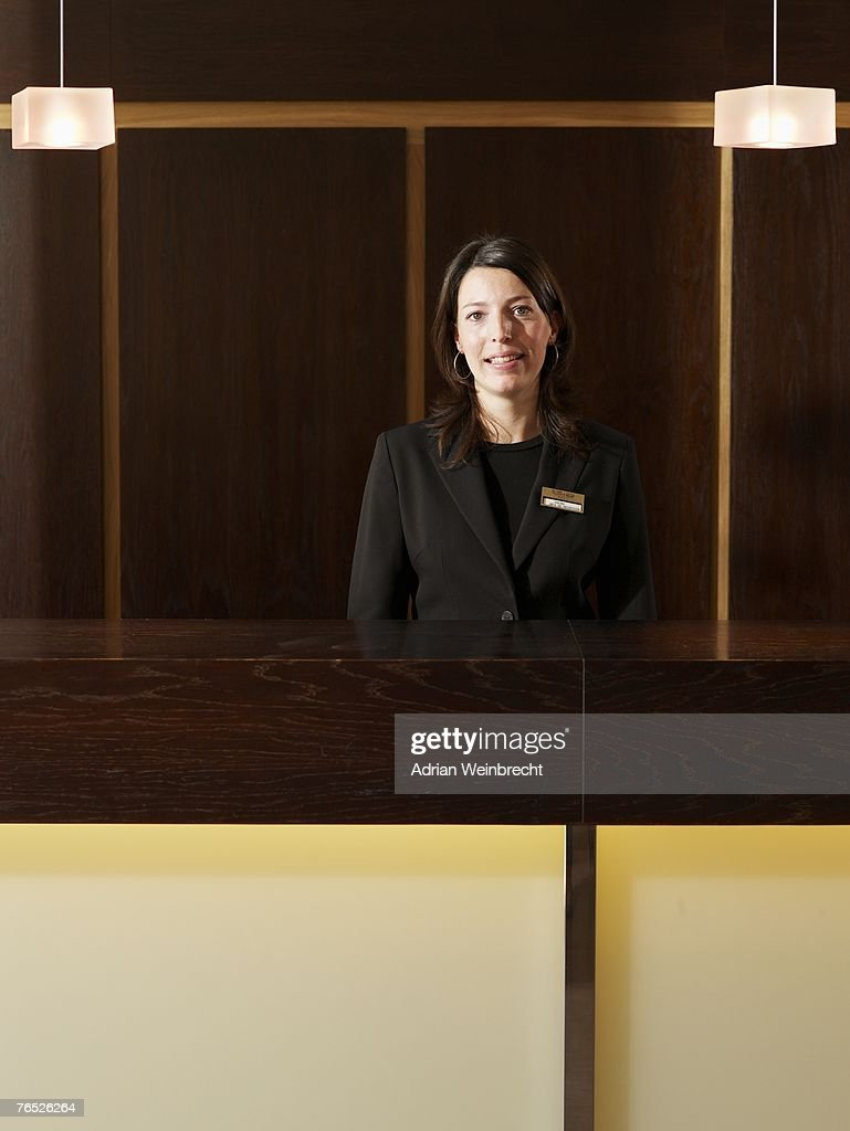 Young Female Hotel Receptionist Smiling Portrait Stock ...