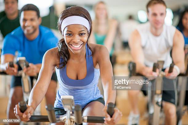 Young Female in Bicycle Spinning Exercise Class