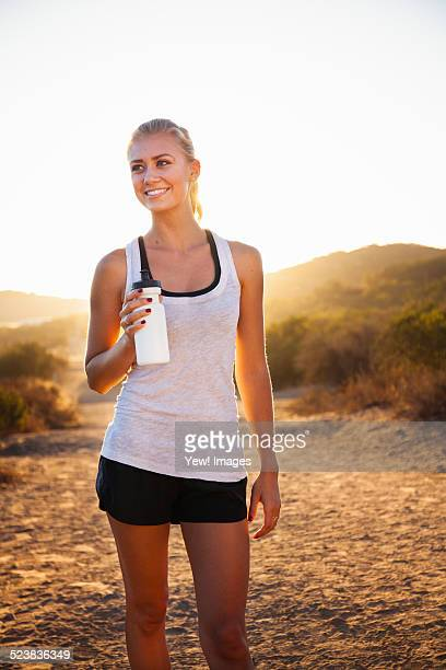 Young female jogger holding water bottle, Poway, CA, USA