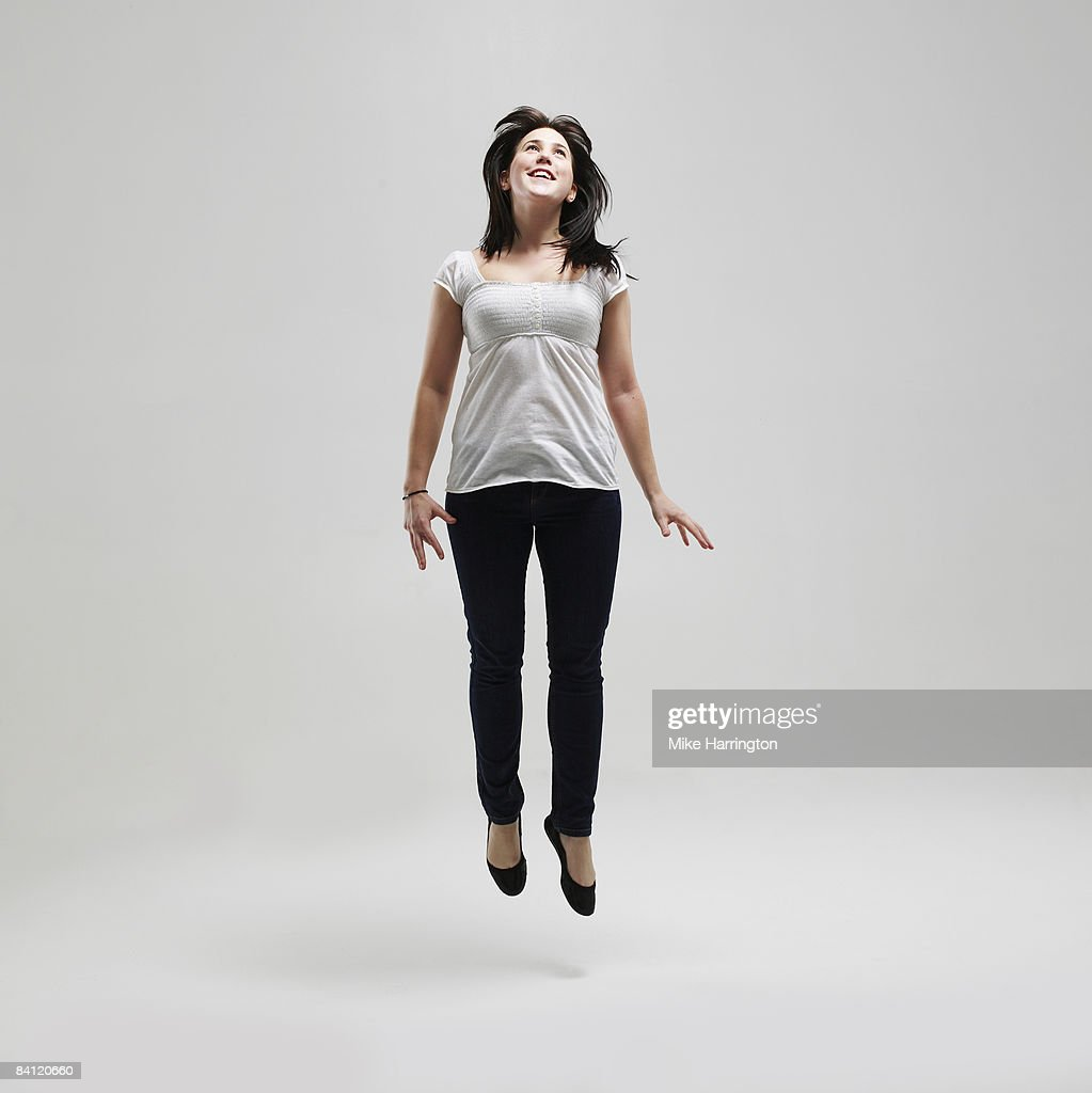 young female jumping for joy stock photo getty images